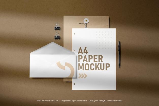 Mockup di carta e buste a4 di cancelleria per il branding