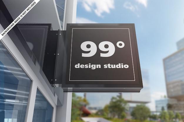 Mockup del segno quadrato di pubblicità edificio
