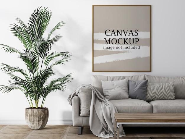 Mockup di cornice in tela accanto alla pianta