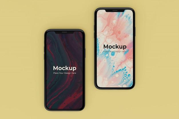 Modelli di design mockup di due schermi mobili realistici modificabili
