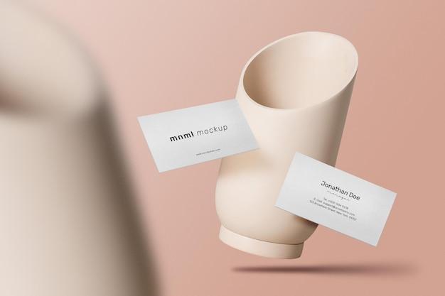 Pulisca il modello minimo del biglietto da visita che galleggia con il fondo dei vasi.