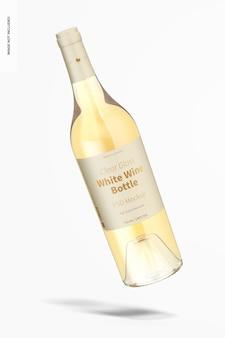 Mockup di bottiglia di vino bianco in vetro trasparente, che cade