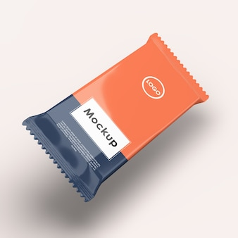 Primo piano sulla barretta di cioccolato in plastica avvolgimento mockup