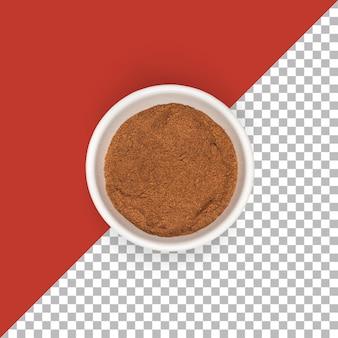 Vista ravvicinata polvere di cannella marrone sulla ciotola bianca.