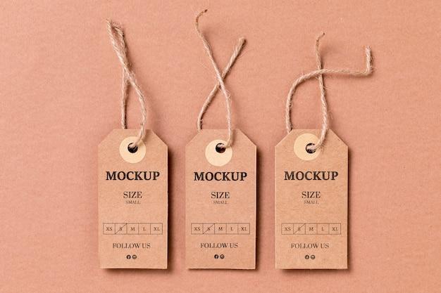 Mock-up etichetta taglia abbigliamento piatto lay