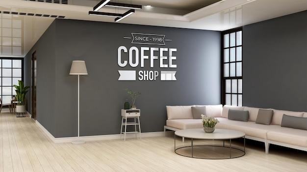 Mockup del logo della parete della caffetteria o del bar per il marchio nella moderna sala bar con divano
