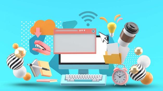 Il computer è circondato da apparecchiature per ufficio su un blu