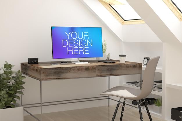 Mockup di schermo del computer nell'ufficio della soffitta