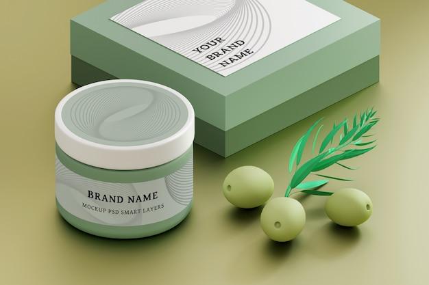 Mockup di packaging cosmetico con vasetto di crema, scatola con etichette vuote e olive verdi