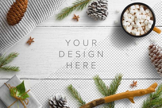 Mockup invernale accogliente con confezione regalo e bevanda calda Psd Premium