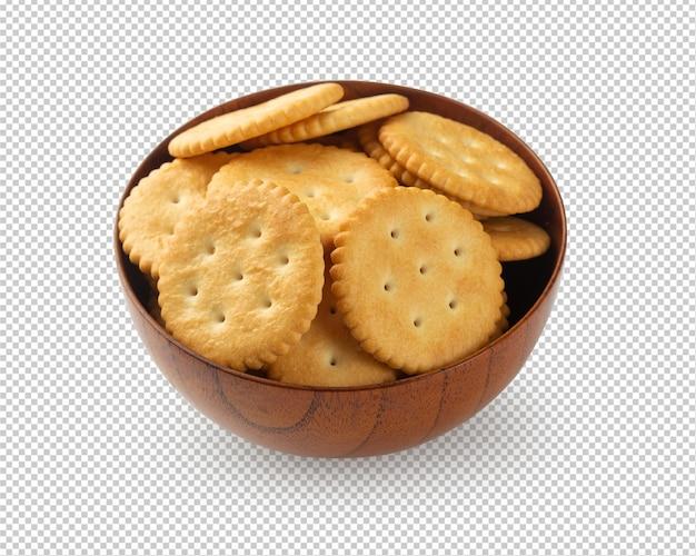 Biscotti del cracker in ciotola di legno isolata
