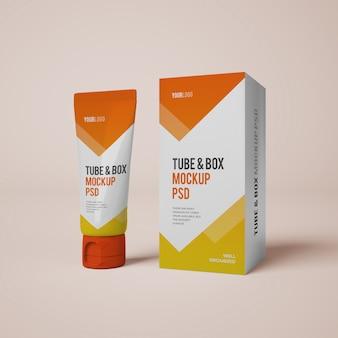Mockup di tubo e scatola color crema con design modificabile