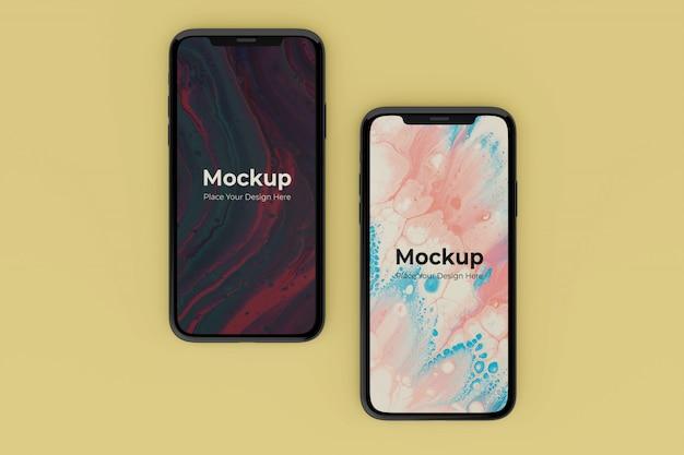 Modelli di design mockup di due schermi mobili realistici personalizzabili