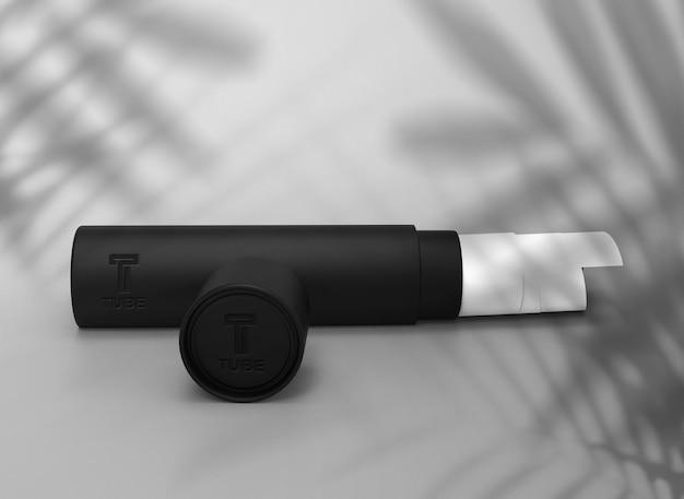Mockup di tubo di carta scuro con ombra fogliare