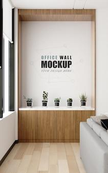 Un posto decorativo nel mockup del muro della sala di gestione