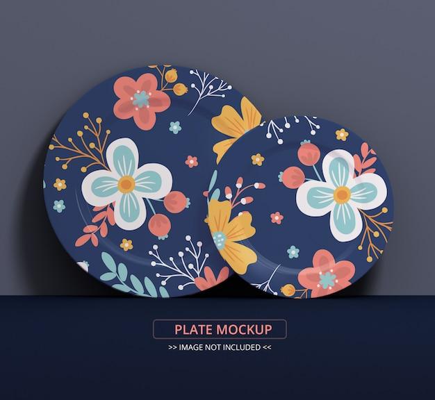Mockup piatto piatto per texture arte e simulazione display, due piatti sul muro Psd Premium