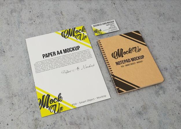Mockup di documenti, quaderni e biglietti da visita