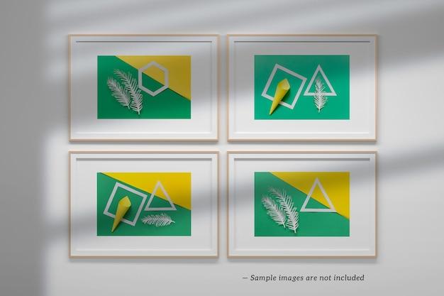 Modello di mockup psd modificabile con quattro cornici a4 orizzontali con sovrapposizione di ombre sul muro