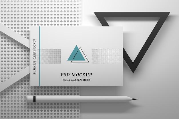 Mockup psd di cancelleria modificabile con biglietto da visita singolo ed elementi geometrici