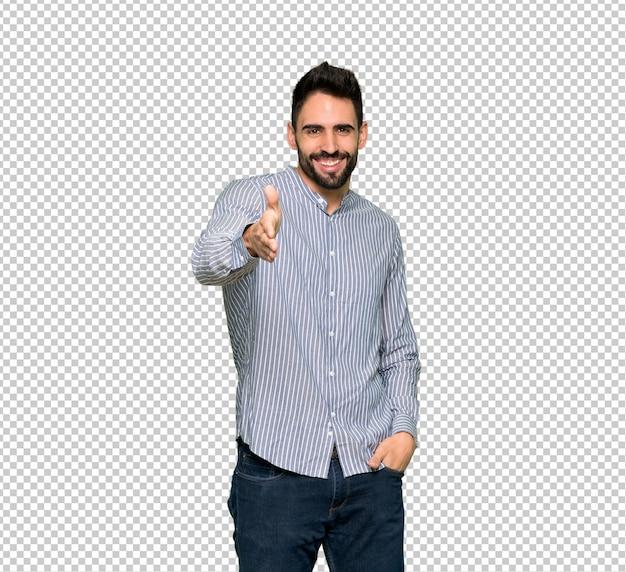 Uomo elegante con la camicia che stringe le mani per la chiusura di un buon affare