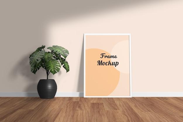 Elegante minimal photo frame mockup in piedi sul pavimento con fiore
