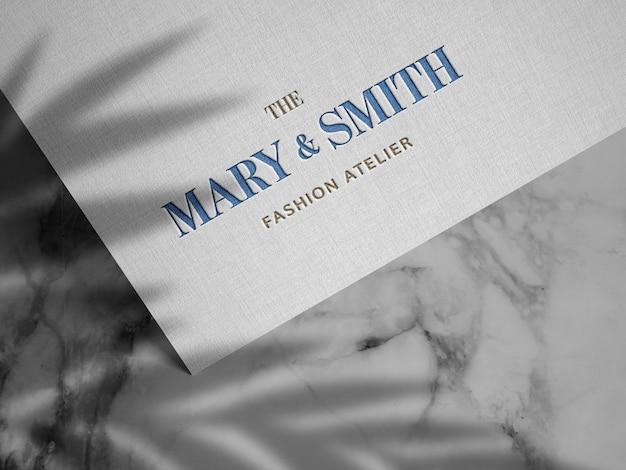 Logo in rilievo su carta di lino