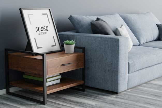 Tavolo in legno cornice vuota e divano in soggiorno rendering 3d