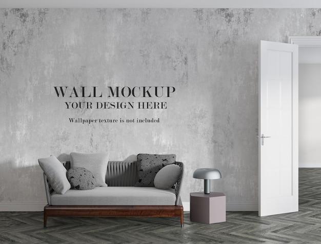 Vuoto mockup design muro dietro un piccolo divano