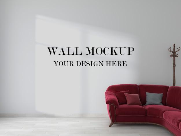 Parete vuota dietro il divano rosso nella rappresentazione 3d