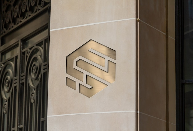 Logo inciso sul mockup del muro dell'azienda in pietra