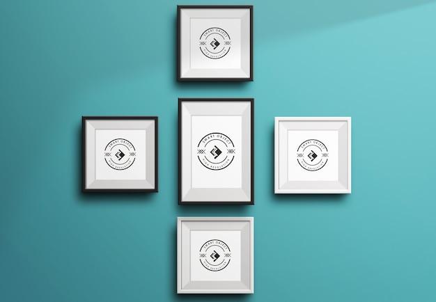 Cinque mockup di cornici per foto vuote appese nel muro vuoto