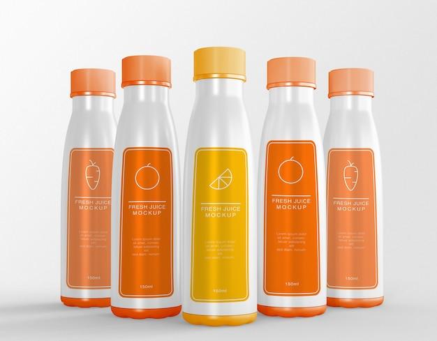 Cinque bottiglie di succo di confezionamento mockup