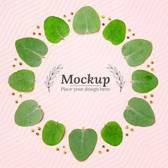 Lay piatto di mock-up con foglie di piante