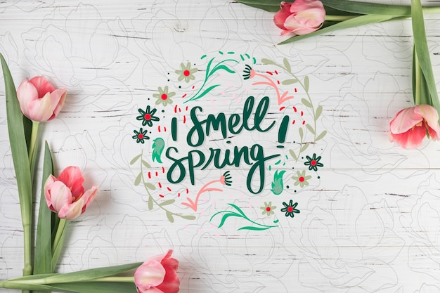 Mockup di primavera piatta laici con copyspace e cornice