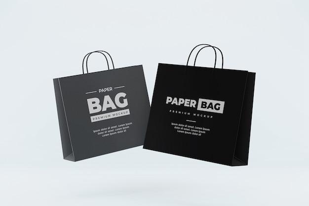 Mockup di sacchetto di carta galleggiante shopping realistico nero e grigio