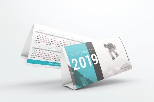 Mockup di calendari scrivania volante