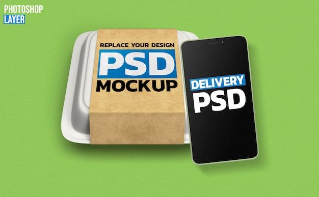 Mockup di cibo scatola e smartphone