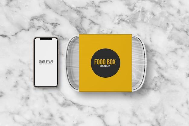 Scatola da asporto alimentare con smartphone mockup