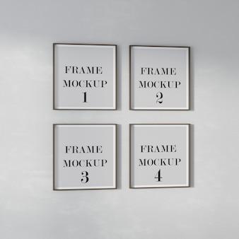 Mockup di quattro cornici quadrate sul muro