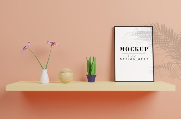 Mockup di cornice con piante e decorazioni