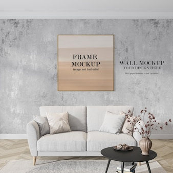 Mockup di cornice e parete dietro il divano