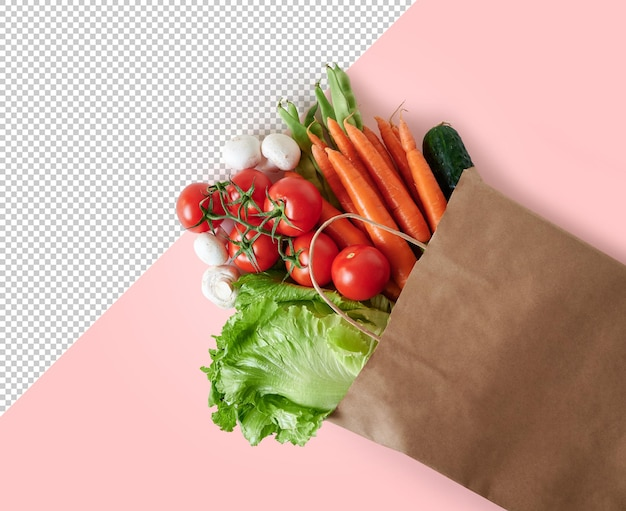 Verdure fresche in sacco di carta riciclabile su sfondo rosa con spazio per le copie
