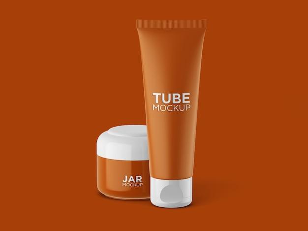 Vista frontale tubo cosmetico e mockup barattolo isolato