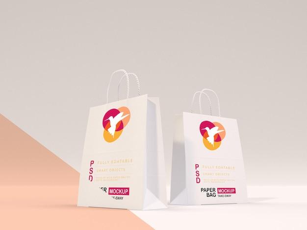 Mockup di borsa di carta bianca completamente modificabile con logo e testo vuoto immagine di shopping con motivi