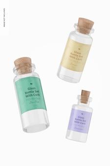 Set di bottiglie di vetro con mockup di sughero, galleggiante