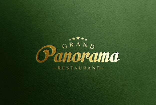 Mockup di logo in lamina d'oro su carta verde