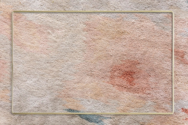 Cornice dorata su un design mockup di tappeti con motivi toni della terra