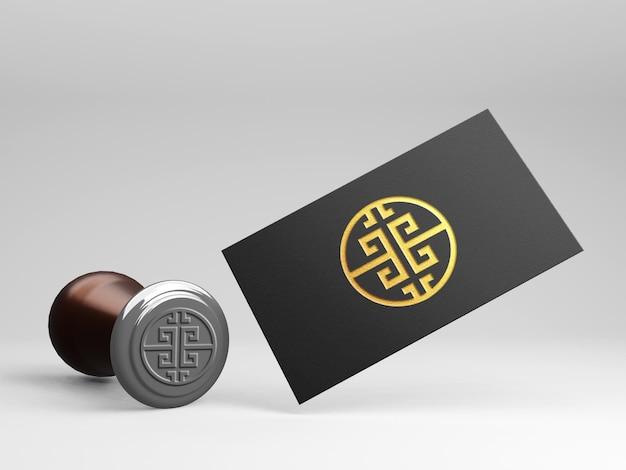 Mockup logo carta di lusso effetto stampa oro con timbro