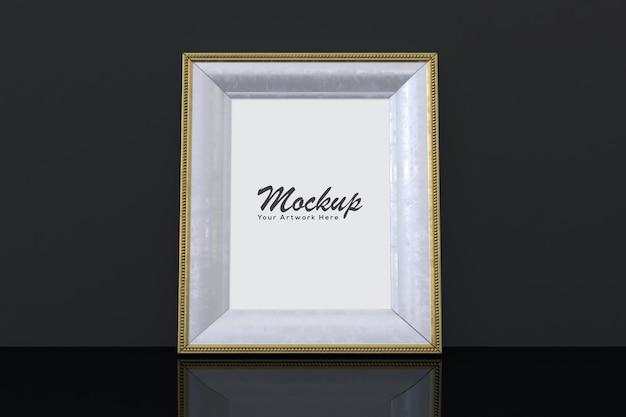 Mockup cornice dorata con sfondo nero