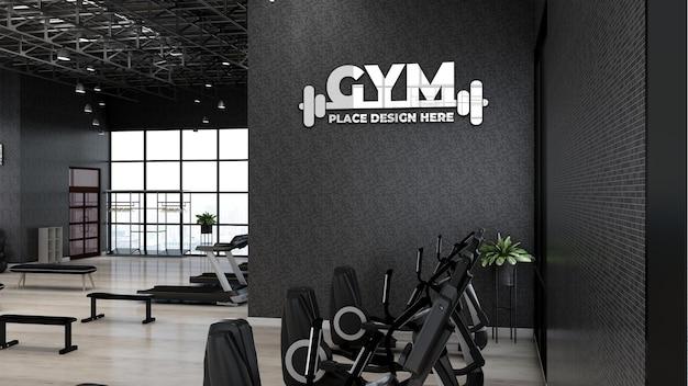 Mockup del logo della parete della palestra nella palestra dell'atleta o nella palestra con parete nera